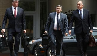 Members of the defense team for Paul Manafort, including Kevin Downing, left, Richard Westling, and Thomas Zehnle, walk to federal court as the trial of the former Trump campaign chairman continues, in Alexandria, Va., Monday, Aug. 13, 2018. The prosecution is expected to rest its case in the fraud trial. (AP Photo/Jacquelyn Martin)