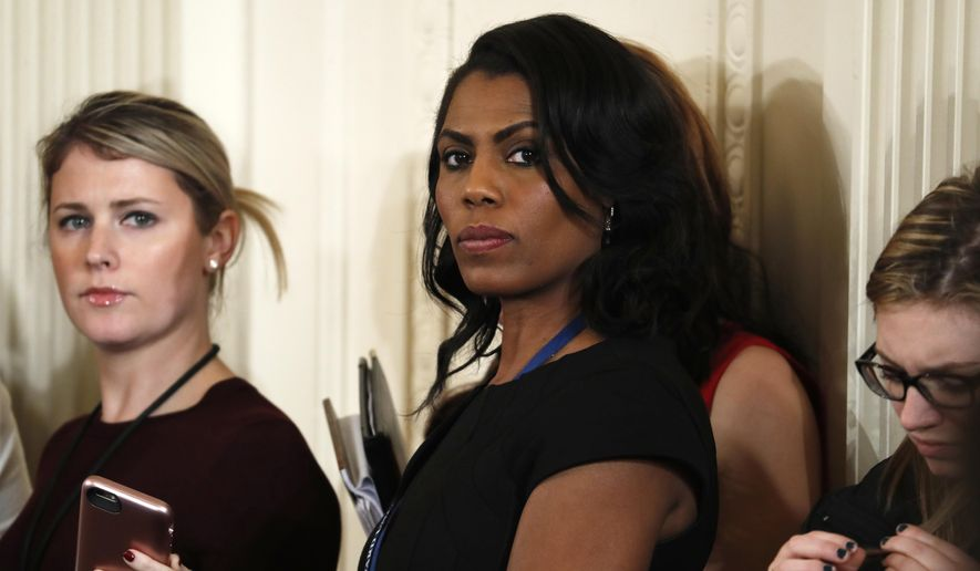 """In this Feb. 13, 2017, file photo, White House Director of Communications for the Office of Public Liaison Omarosa Manigault Newman waits for the start of a joint news conference with President Donald Trump and Canadian Prime Minister Justin Trudeau at the White House in Washington. Manigault Newman, who was fired in December, released a new book """"Unhinged,"""" about her time in the White House. (AP Photo/Pablo Martinez Monsivais, File)"""