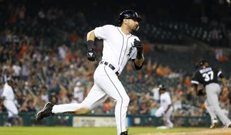 Detroit Tigers' Nicholas Castellanos rounds first base on a two-run single in the eighth inning of a baseball game against the Chicago White Sox in Detroit, Monday, Aug. 13, 2018. (AP Photo/Paul Sancya)
