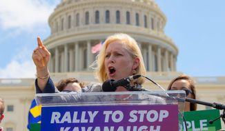 Sen. Kirsten Gillibrand joins protesters objecting to President Trump's Supreme Court nominee Judge Brett M. Kavanaugh, at a rally. (ASSOCIATED PRESS)