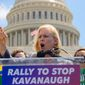 Sen. Kirsten Gillibrand, D-N.Y., joins protesters objecting to President Donald Trump's Supreme Court nominee Judge Brett M. Kavanaugh, at a rally Capitol in Washington, Wednesday, Aug. 1, 2018. (AP Photo/J. Scott Applewhite)