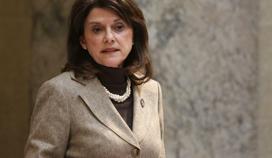 FILE - In this Nov. 7, 2017, file photo, Wisconsin state Sen. Leah Vukmir stands in the Senate chambers at the state Capitol in Madison. Vukmir, a Wisconsin state senator and close ally to Gov. Scott Walker, defeated a former Marine who cast himself as a political outsider to win the Republican primary for U.S. Senate on Tuesday, Aug. 14, 2018. (Michelle Stocker/The Capital Times via AP, File)