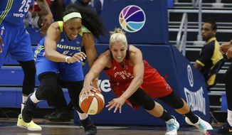 File-This June 6, 2017, file photo shows Dallas Wings forward Kayla Thornton (6) and Washington Mystics guard Elena Delle Donne (11) diving after a loose ball during the first half of a WNBA basketball game in Arlington, Texas. Delle Donne was named AP Player of the Week  for Aug. 6-12,  after averaging 27.7 points, 5.7 rebounds, 2.3 assists to help Washington go 3-0 this week. (Vernon Bryant/The Dallas Morning News via AP, File) **FILE**