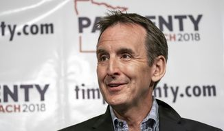 In this May 31, 2018, file photo, former Minnesota Gov. Tim Pawlenty speaks at a news conference in St. Paul, Minn. Minnesota Democrats are settling a three-way battle for governor in a stacked primary election, while former two-term Gov. Tim Pawlenty is seeking to win back his old job on the Republican side. (Glen Stubbe/Star Tribune via AP, File)