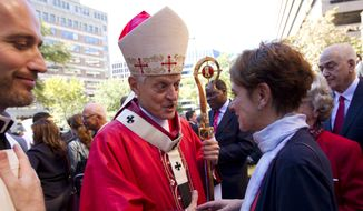 This Oct. 1, 2017, file photo shows Cardinal Donald Wuerl, Archbishop of Washington shaking hands with churchgoers at St. Mathews Cathedral after the Red Mass in Washington. Wuerl is defending himself ahead of a forthcoming grand jury report investigating child sexual abuse in six of Pennsylvania's Roman Catholic dioceses. He says the report will be critical of some of his actions as Pittsburgh's bishop. (AP Photo/Jose Luis Magana, File)