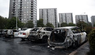 "Burned cars parked at Frolunda Square in Gothenburg, Tuesday,  Aug. 14, 2018. Masked youth torched dozens of cars overnight in Sweden and threw rocks at police, prompting an angry response from the prime minister, who on Tuesday spoke of an ""extremely organized"" night of vandalism. (Adam Ihse/TT via AP)"