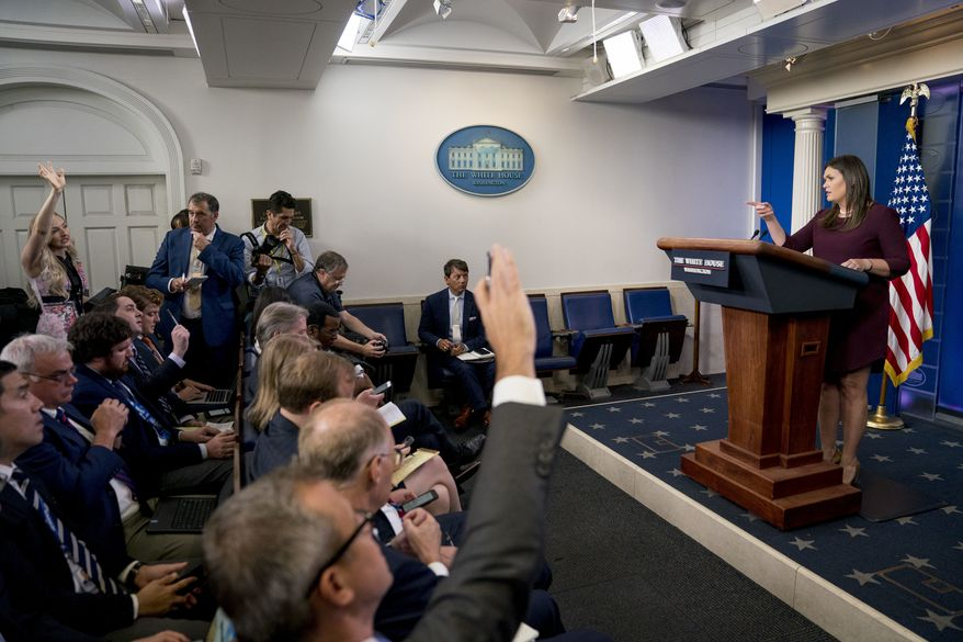 White House press secretary Sarah Huckabee Sanders calls on a reporter during the daily press briefing at the White House, Tuesday, Aug. 14, 2018, in Washington. Sanders took questions about former White House staffer Omarosa Manigault and other topics. (AP Photo/Andrew Harnik)