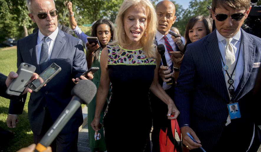 Counselor to the President Kellyanne Conway, center, accompanied by Deputy White press secretary Hogan Gidley, right, speaks to reporters outside the West Wing in Washington, Tuesday, Aug. 14, 2018. (AP Photo/Andrew Harnik)