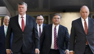 Members of the defense team for Paul Manafort, including from left, Jay Nanavati, Kevin Downing, Brian Ketcham, Richard Westling, and Thomas Zehnle, walk to federal court as the trial of the former Trump campaign chairman continues, in Alexandria, Va., Tuesday, Aug. 14, 2018. The focus in Paul Manafort's fraud trial shifts to the defense after prosecutors rested their case. (AP Photo/Jacquelyn Martin)