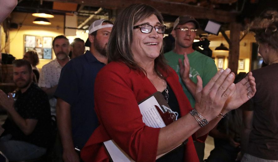 Vermont Democratic gubernatorial candidate Christine Hallquist, a transgender woman and former electric company executive, applauds with her supporters during her election night party in Burlington, Vt., Tuesday, Aug. 14, 2018. (AP Photo/Charles Krupa)