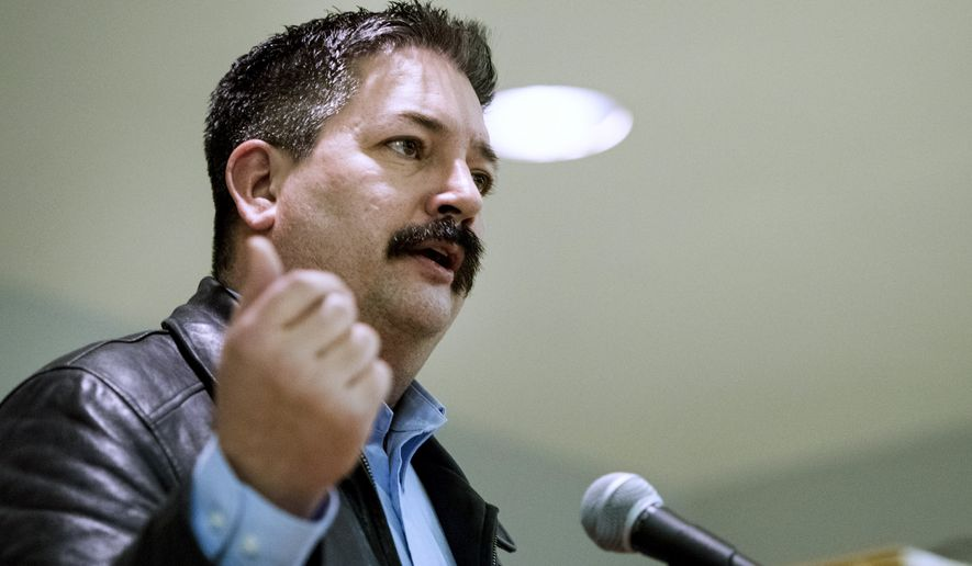"FILE - In this Feb. 8, 2018, file photo, union iron worker Randy Bryce, a Democratic primary candidate in Wisconsin's 1st Congressional District, addresses supporters in Janesville. Bryce, a union ironworker known as ""Iron Stache,"" won the Democratic primary Tuesday, Aug. 14, 2018, in the race to replace retiring House Speaker Paul Ryan. (Angela Major/The Janesville Gazette via AP, File)"