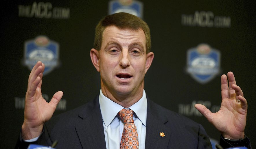 File-This Dec. 1, 2017, file photo shows Clemson coach Dabo Swinney speaking during an NCAA college football press conferences for the Atlantic Coast Conference championship game in Charlotte, N.C. Swinney's Tigers are the heavy favorite to become the first ACC team to win four straight league titles since Florida State's dominating run through the 1990s.(Diedra Laird/The Charlotte Observer via AP, File)