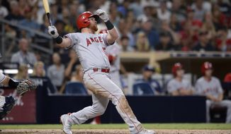 Los Angeles Angels' Kole Calhoun watches his RBI ground-rule double during the 10th inning of a baseball game against the San Diego Padres, Monday, Aug. 13, 2018, in San Diego. (AP Photo/Orlando Ramirez)