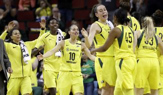 File-This June 15, 2018, file photo shows Seattle Storm's Alysha Clark, left, Natasha Howard, Sue Bird (10) and Breanna Stewart coming off the bench to greet teammates during a timeout in the first half of a WNBA basketball game against the Connecticut Sun in Seattle. About the only thing that has been decided when it comes to the postseason is Seattle will have a bye to the semifinals. Atlanta is close to wrapping up a top two seed, but finishes the season with two more games on the road. Washington, Connecticut, Los Angeles, Phoenix and Minnesota are all jockeying for a first-round bye. (AP Photo/Elaine Thompson, File)