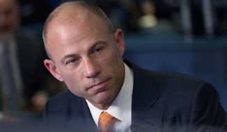 FILE - In this May 10, 2018 file photo, Michael Avenatti is interviewed on the Cheddar network, Thursday, May 10, 2018, in New York. Avenatti, the attorney taking on President Donald Trump on behalf of an adult film star, offered some details on his policy views Tuesday as he weighs an outsider Democratic bid for the White House. (AP Photo/Mark Lennihan)