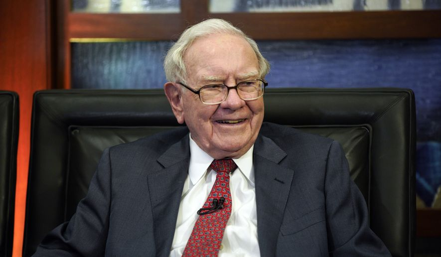 "In this May 7, 2018, photo, Berkshire Hathaway Chairman and CEO Warren Buffett smiles during an interview in Omaha, Neb., with Liz Claman on Fox Business Network's ""Countdown to the Closing Bell."" Buffett's company added to its stakes in Apple and Israeli drugmaker Teva Pharmaceuticals in the second quarter while tweaking several of its other stock investments. Berkshire Hathaway Inc. filed an update on its U.S. stock portfolio with the Securities and Exchange Commission on Tuesday, Aug. 14. (AP Photo/Nati Harnik)"