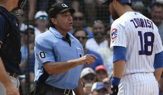 Chicago Cubs' Ben Zobrist (18) argues a strike call with umpire Phil Cuzzi (10) during the sixth inning of a baseball game, Tuesday, Aug. 14, 2018, in Chicago. (AP Photo/David Banks)