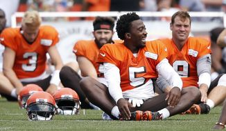 Cleveland Browns quarterbacks Tyrod Taylor (5), Brogan Roback (3), Baker Mayfield and Drew Stanton (9) stretch during NFL football training camp Sunday, Aug. 12, 2018, in Berea, Ohio. (AP Photo/Ron Schwane)