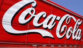 This June 25, 2012, file photo shows the Coca-Cola logo on the side of a delivery truck in Springfield, Ill. (AP Photo/Seth Perlman, File)