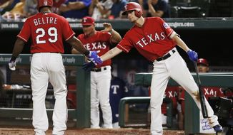Texas Rangers' Adrian Beltre (29) is congratulated by Carlos Tocci, right, after scoring on an RBI single hit by Robinson Chirinos, not pictured, during the eighth inning of a baseball game against the Arizona Diamondbacks, Monday, Aug. 13, 2018, in Arlington, Texas. Texas won 5-3. (AP Photo/Brandon Wade)