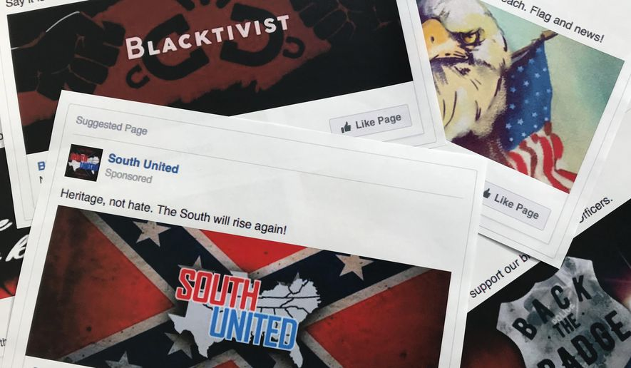 his Nov. 1, 2017, file photo shows some of the Facebook ads linked to a Russian effort to disrupt the American political process and stir up tensions around divisive social issues, released by members of the U.S. House Intelligence committee, are photographed in Washington. Groups tied to the Russian government have been trying to meddle in U.S. politics since at least the 2016 elections. (AP Photo/Jon Elswick, File)