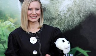 "FILE - In this March 17, 2018 file photo, Kristen Bell holds a stuffed panda teddy bear at the LA Premiere of ""Pandas"" in Los Angeles. Bell narrates the documentary which will be in wide release beginning Friday. (Photo by Willy Sanjuan/Invision/AP)"