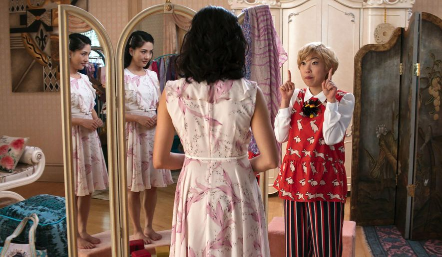 "This image released by Warner Bros. Entertainment shows Constance Wu, left, and Awkwafina in a scene from the film ""Crazy Rich Asians."" (Warner Bros. Entertainment via AP)"
