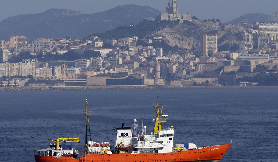 """FILE - In this Aug.1, 2018 file photo, the French NGO """"SOS Mediterranee"""" Aquarius ship leaves the Marseille harbor, southern France. he European Commission said Monday Aug.13, 2018 that it is in contact with a number of member states to identify a country willing to take 141 migrants picked up by a rescue ship, after the French aid groups operating the ship appealed for a safe port and Italy said Britain should take responsibility. (AP Photo/Claude Paris, File)"""