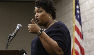 Democratic candidate for governor Stacey Abrams speaks during a town hall forum at the Dalton Convention Center on Wednesday, Aug. 1, 2018, in Dalton, Ga. Abrams is running against Republican candidate Brian Kemp in Georgia's November general election. (Doug Strickland/Chattanooga Times Free Press via AP)