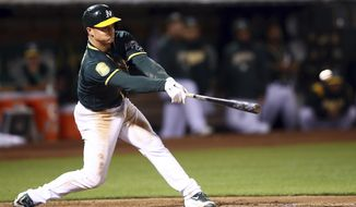 Oakland Athletics' Matt Chapman connects for a two-run double off Seattle Mariners' Casey Lawrence in the sixth inning of a baseball game, Monday, Aug. 13, 2018, in Oakland, Calif. (AP Photo/Ben Margot)