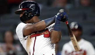 Atlanta Braves left fielder Ronald Acuna Jr. (13) drives in a run with a single in the sixth inning of the second baseball game of a doubleheader against the Miami Marlins Monday, Aug. 13, 2018 in Atlanta. There Braves won 6-1. (AP Photo/John Bazemore)