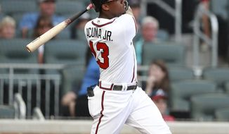 Atlanta Braves' Ronald Acuna Jr. hits a lead-off home run in the first inning of a baseball game against the Miami Marlins Tuesday, Aug. 14, 2018 in Atlanta. (Curtis Compton/Atlanta Journal-Constitution via AP)
