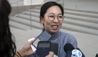 Yea Ji Sea, a former U.S. Army specialist who was born in South Korea, talks with reporters after a federal court hearing in Los Angeles Tuesday, Aug. 14, 2018. Sea filed a lawsuit in July, 2018, demanding a response to her citizenship application after the military moved to discharge her. She has since been discharged. U.S. District Judge Michael Fitzgerald says the government will have to rule on Sea's application by Sept. 5 or explain the delay to the court. (AP Photo/Ariel Tu)
