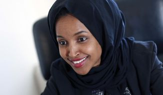 FILE - In this Jan. 5, 2017, file photo, state Rep. Ilhan Omar is interviewed in her office two days after the 2017 Legislature convened in St. Paul, Minn. Decisions by three Minnesota Democrats to leave the House set off a land rush for their open seats, with one race featuring Somali-American lawmaker Ilhan Omar's attempted leap to Congress. (AP Photo/Jim Monem File)
