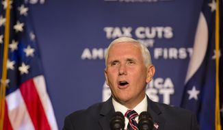 Vice President Mike Pence speaks during the Tax Cuts to Put America First event at The Westin in downtown Cincinnati, Ohio, on Tuesday, Aug. 14, 2018. (Albert Cesare/The Cincinnati Enquirer via AP)