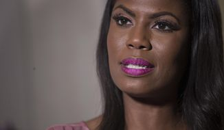 """Television personality and former White House staffer Omarosa Manigault Newman speaks during an interview with The Associated Press, Tuesday, Aug. 14, 2018, in New York. Manigault Newman declared she """"will not be silenced"""" by President Donald Trump, remaining defiant as her public feud with her former boss shifted from a war of words to a possible legal battle. (AP Photo/Mary Altaffer)"""