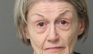 This undated photo provided by the Wake City-County Bureau of Identification on Tuesday, Aug. 14, 2018, shows Roxanne Reed, 65, of Garner, N.C. She was accused of plotting to kill her 88-year-old mother after police investigated an online romance scam she was involved in. (AP Photo/Wake City-County Bureau of Identification)