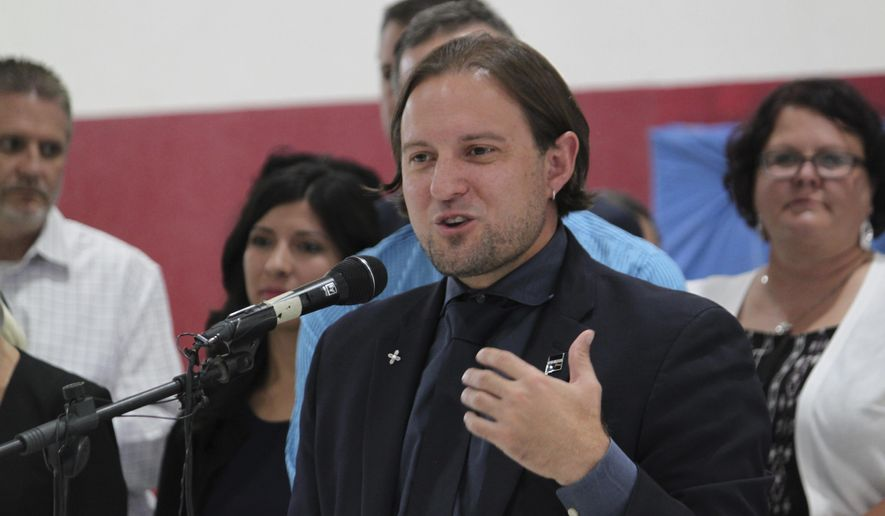 FLE--In this July 12, 2018 file photo, New Mexico Public Education Secretary Christopher Ruszkowski announces the results of this year's standardized assessments during an event at North Valley Academy in Los Ranchos, N.M. New Mexico school districts now will get student test scores by the end of the school year and will have 15 more days to prepare for statewide exams Ruszkowski said Tuesday, Aug. 14, 2018, after receiving feedback. (AP Photo/Susan Montoya Bryan, file)