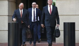 Members of the defense team for Paul Manafort, including Thomas Zehnle, left, Brian Ketcham, and Kevin Downing, leave federal court during a break of the trial of former Donald Trump campaign chairman Paul Manafort, in Alexandria, Va., Tuesday, Aug. 14, 2018. The defense has rested their case. (AP Photo/Jacquelyn Martin)