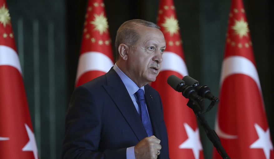 Turkey's President Recep Tayyip Erdogan, gestures as he delivers a speech to Turkish ambassadors at the Presidential Palace in Turkey, Monday, Aug. 13, 2018. (Pool Photo via AP)