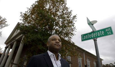 In this Wednesday, Nov. 8, 2017, photo, Bishop O.C. Allen III stands outside his church, which is a few feet away from Confederate Avenue, in Atlanta. A roadway in Atlanta serves as a concrete reminder that Georgia once took up arms against the United States of America. It's called Confederate Avenue. (AP Photo/David Goldman)