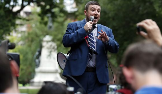 "White nationalist Jason Kessler speaks at a rally near the White House on the one year anniversary of the Charlottesville ""Unite the Right"" rally, Sunday, Aug. 12, 2018, in Washington. (AP Photo/Alex Brandon)"