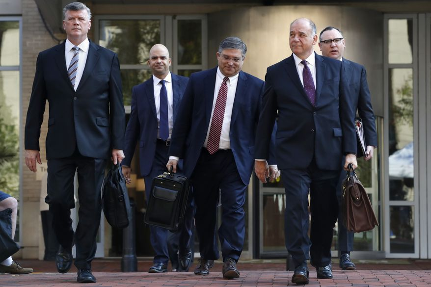 Members of the defense team for Paul Manafort, from left, Kevin Downing, Jay Nanavati, Richard Westling, Thomas Zehnle, and Brian Ketcham, walk to federal court for closing arguments in the trial of the former Trump campaign chairman, in Alexandria, Va., Wednesday, Aug. 15, 2018. (AP Photo/Jacquelyn Martin)
