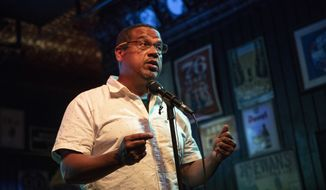 Rep. Keith Ellison speaks to supporters after winning the Democratic nomination for Attorney General during his primary party at Nomad World Pub, Tuesday, Aug. 14, 2018, in Minneapolis. (Renee Jones Schneider/Star Tribune via AP)