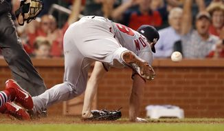 Washington Nationals starting pitcher Jeremy Hellickson is injured while covering home after throwing a wild pitch scoring St. Louis Cardinals' Harrison Bader during the fifth inning of a baseball game Wednesday, Aug. 15, 2018, in St. Louis. Hellickson left the game. (AP Photo/Jeff Roberson)