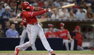 Los Angeles Angels' Justin Upton hits a two-run home run during the fifth inning of a baseball game against the San Diego Padres, Tuesday, Aug. 14, 2018, in San Diego. (AP Photo/Orlando Ramirez)