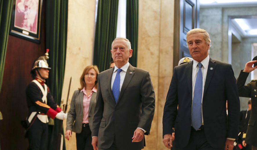 U.S. Secretary of Defense Jim Mattis, left, and Argentina's Defense Minister Oscar Raul Aguad arrive for a press conference in Buenos Aires, Argentina Wednesday, Aug. 15, 2018. Mattis is on an official visit to several South American countries. (AP Photo/Natacha Pisarenko)