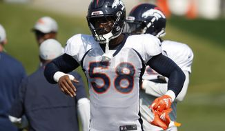 Denver Broncos linebacker Von Miller takes part in drills during a joint NFL football training camp session against the Chicago Bears Wednesday, Aug. 15, 2018, at Broncos' headquarters in Englewood, Colo. (AP Photo/David Zalubowski)