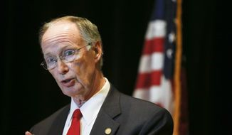 FILE - In a Monday, Sept. 19, 2016 file photo, Alabama Gov. Robert Bentley speaks to the media during a news conference, in Hoover, Ala. Former Gov. Robert Bentley provided new details in a deposition about his view of the scandal that helped topple his administration. The June 2018 deposition was filed recently in an ongoing civil lawsuit. Bentley resigned last year as he faced an ethics investigation and impeachment push in the wake of an alleged affair with a top aide. (AP Photo/Brynn Anderson, File)