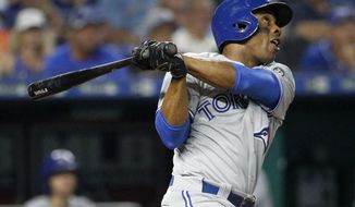 Toronto Blue Jays' Curtis Granderson watches his grand slam during the fourth inning of a baseball game against the Kansas City Royals on Wednesday, Aug. 15, 2018, in Kansas City, Mo. (AP Photo/Charlie Riedel)